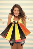 Happy shopper girl with shopping bags. happy shopper after day shopping. girl hold colorful sale paperbags. special. Offer and benefit concept. paper bags in royalty free stock images