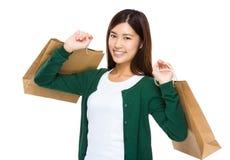 Happy shopper holding shopping bag. Isolated on white background stock images