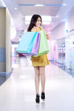 Happy shopper holding shopping bags Stock Photography