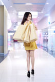 Happy shopper holding shopping bags Stock Images