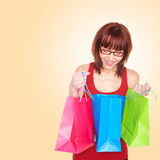 Happy Shopper Lookig At Purchases Royalty Free Stock Images