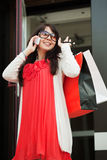 Happy shopper on the phone. Stock Photography