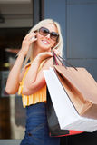 Happy woman calling on the phone. Young woman with shopping bags calling on the phone Stock Photo