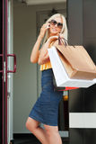 Happy shopper on the phone Royalty Free Stock Photography