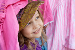 Happy shopper. Portrait of a little shopper in colorful clothes royalty free stock photography