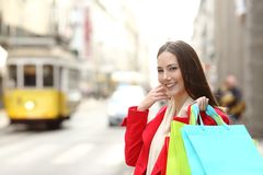 Happy shopper shopping in a city old town royalty free stock photo