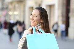 Happy shopper showing blank shopping bag royalty free stock images