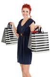 Happy shopper showing her bags Stock Image
