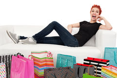 Happy shopper surrounded with bags Stock Photography