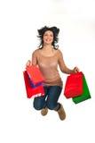 Happy shopper woman jumping stock photo