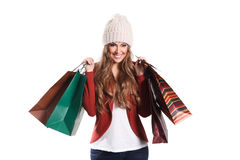 Happy shopper woman with paper bags Stock Photos