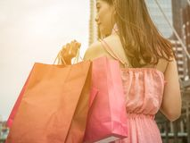 Happy shopper, Women hold shopping bag after shop from Black Friday sale.  stock photo