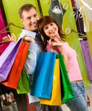 Happy shoppers Stock Photos