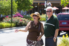 Happy Shoppers. Senior couple can't hide good feelings Stock Photos