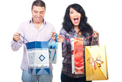 Happy shoppers couple with bags. Happy shoppers couple holding shopping bags and being very satisfied of what they bought isolated on white background Stock Photos