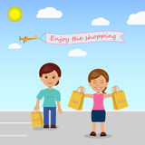 Happy shoppers in the parking lot at the store.  Royalty Free Stock Images
