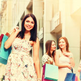 Happy shoppers with purchases Royalty Free Stock Images