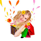 Happy shopping. Happy blond girl with shopping bags in spring concept. Isolated on white background Stock Photography