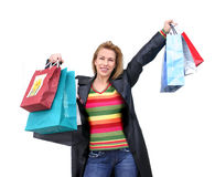 Happy shopping. Girl with hands full of bags Royalty Free Stock Images