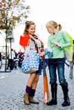 Happy shopping children. Two young children hanging around the streets while shopping Royalty Free Stock Images