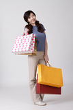 Happy shopping Chinese lady Stock Images