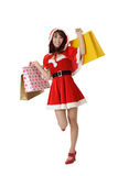 Happy shopping Christmas woman Stock Photos