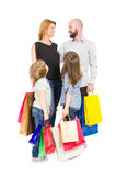 Happy shopping family. With shopping bags isolated on white background Royalty Free Stock Image