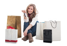 Happy shopping female holding credit or debit card Royalty Free Stock Photos