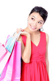 Happy Shopping Girl Holding bag i Stock Images