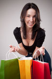 Happy shopping girl holding bags Stock Image