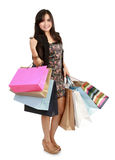 Happy shopping girl holding bags Stock Photo
