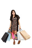 Happy shopping girl holding bags Royalty Free Stock Photography