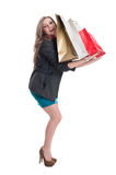 Happy shopping girl holding bags on her arms Stock Photography