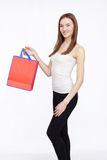 Happy shopping girl holding shoping bag in hands Royalty Free Stock Photos