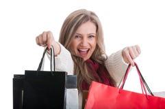 Happy shopping girl showing shopping bags Stock Image