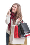 Happy shopping girl talking on the phone Royalty Free Stock Photos