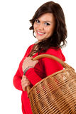 Happy shopping girl with wicker basket Royalty Free Stock Images