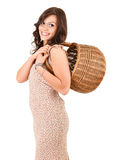 Happy shopping girl with wicker basket Stock Images