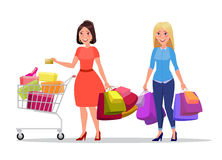 Happy shopping girl or woman with bags. Big Sale. Two happy shopping girls or women. Brunette with golden credit card and bags or packages with purchases and Royalty Free Stock Image