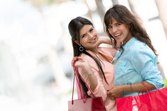 Happy shopping girls Stock Photos