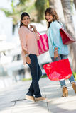 Happy shopping girls Stock Photography
