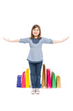 Happy shopping kid or young girl standing Royalty Free Stock Image