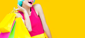 Happy shopping lady. On yellow background Stock Image