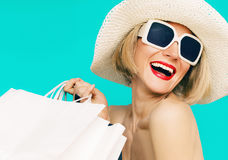 Happy shopping summer lady on blue background.  Stock Photography