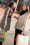 Happy Shopping: Two Women with bags Stock Photos
