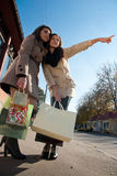 Happy Shopping: Two Young Women with bags Stock Photos