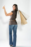 Happy shopping woman. Attractive smiling shopping woman with bags on her hand making a good sign Stock Photo