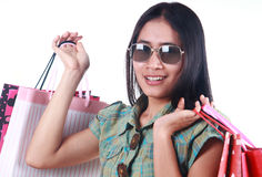 Happy shopping woman. Happy asian woman with shopping bags on white background Royalty Free Stock Images