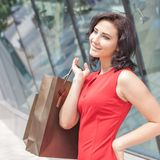 Happy shopping woman with a bag outdoor Stock Images