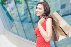 Happy shopping woman with a bag outdoor Royalty Free Stock Images